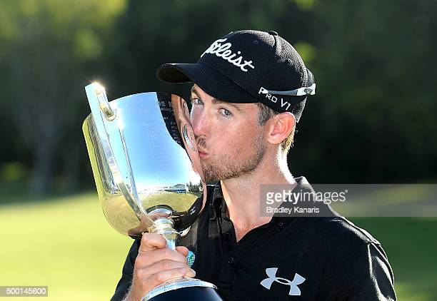 Nathan Holman of Australia celebrates victory as he holds up the Kirkwood Cup during the 2015 Australian PGA Championship at Royal Pines Resort on...