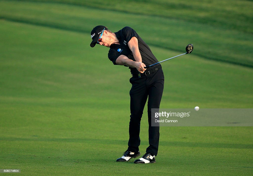 Nathan Holman of Australia plays his second shot on the par 5 10th hole during the first round of the 2016 Omega Dubai Desert Classic on the Majlis...