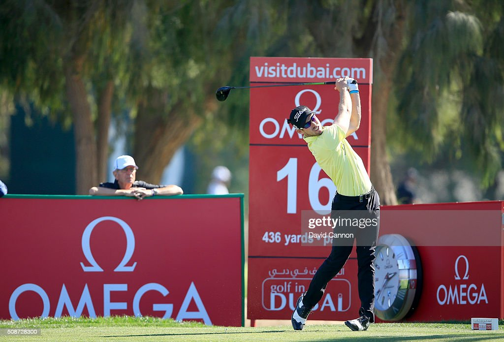 <a gi-track='captionPersonalityLinkClicked' href=/galleries/search?phrase=Nathan+Holman+-+Golfer&family=editorial&specificpeople=15366961 ng-click='$event.stopPropagation()'>Nathan Holman</a> of Australia plays his tee shot at the par 4, 16th hole during the third round of the 2016 Omega Dubai Desert Classic on the Majlis Course at the Emirates Golf Club on February 6, 2016 in Dubai, United Arab Emirates.