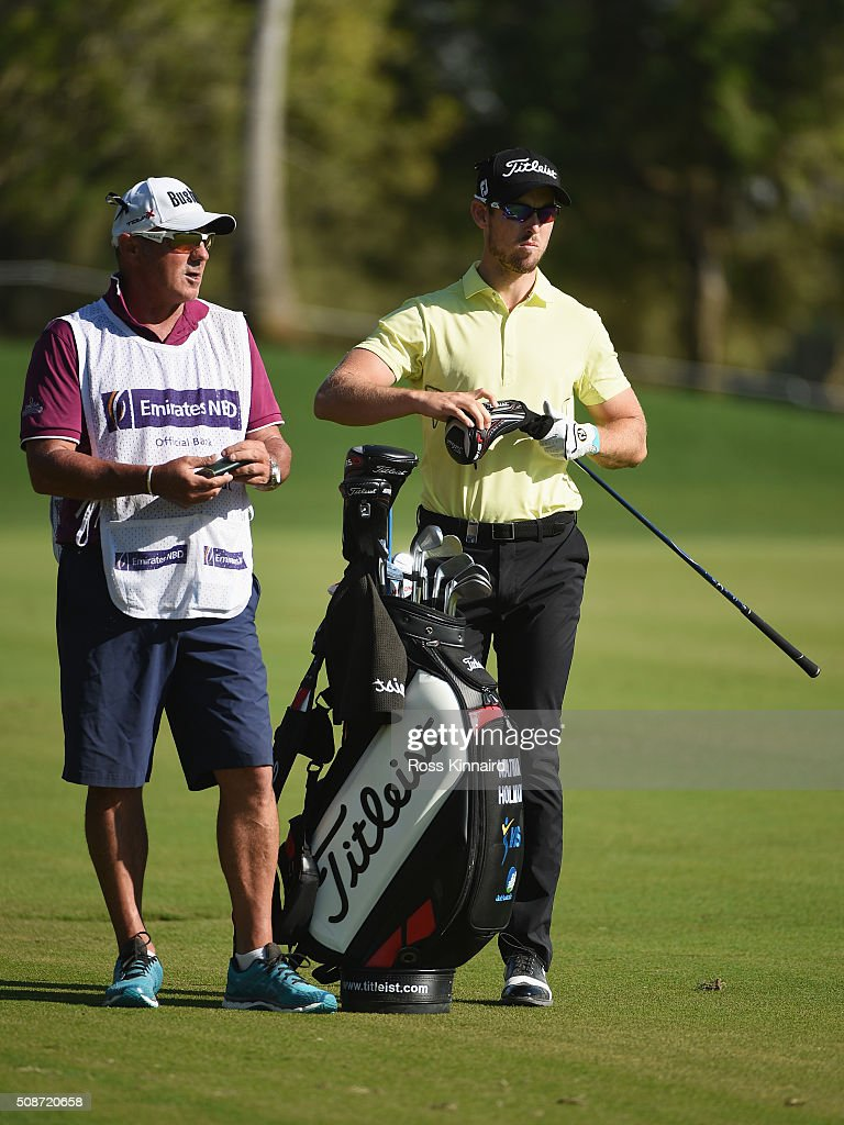 <a gi-track='captionPersonalityLinkClicked' href=/galleries/search?phrase=Nathan+Holman+-+Golfer&family=editorial&specificpeople=15366961 ng-click='$event.stopPropagation()'>Nathan Holman</a> of Australia selects a club with his caddie prior to playing his second shot on the 18th hole during the third round of the Omega Dubai Desert Classic at the Emirates Golf Club on February 6, 2016 in Dubai, United Arab Emirates.