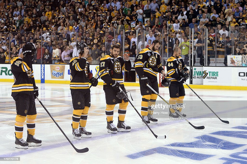 Nathan Horton #18, David Krejci #46, Milan Lucic #17, Zdeno Chara #33 and Dennis Seidenberg #44 of the Boston Bruins look on during player introductions for Game Three of the 2013 NHL Stanley Cup Final against the Chicago Blackhawks at TD Garden on June 17, 2013 in Boston, Massachusetts.