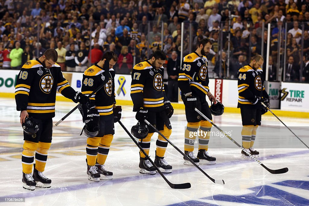 Nathan Horton #18, David Krejci #46, Milan Lucic #17, Zdeno Chara #33 and Dennis Seidenberg #44 of the Boston Bruins stand during the National Anthem prior to Game Four of the 2013 NHL Stanley Cup Final against the Chicago Blackhawks at TD Garden on June 19, 2013 in Boston, Massachusetts.