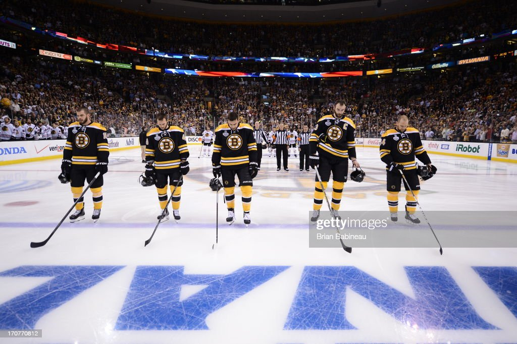 Nathan Horton #18, David Krejci #46, Milan Lucic #17, Zdeno Chara #33 and Rich Peverley #49 of the Boston Bruins stand on the ice as the starting lineup against the Chicago Blackhawks in Game Three of the Stanley Cup Final at TD Garden on June 17, 2013 in Boston, Massachusetts.