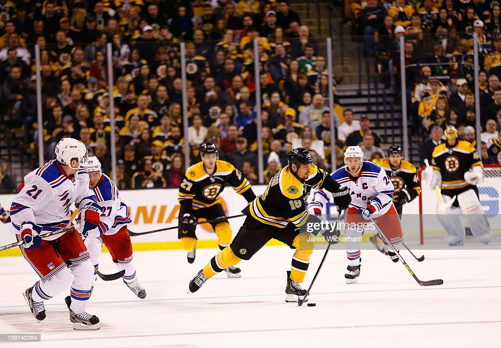 <a gi-track='captionPersonalityLinkClicked' href=/galleries/search?phrase=Nathan+Horton&family=editorial&specificpeople=204741 ng-click='$event.stopPropagation()'>Nathan Horton</a> #18 of the Boston Bruins carries the puck down the ice against the New York Rangers during the season opener game on January 19, 2013 at TD Garden in Boston, Massachusetts.