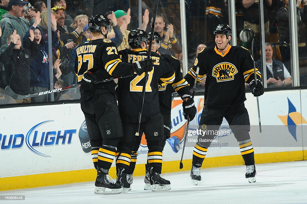 <a gi-track='captionPersonalityLinkClicked' href=/galleries/search?phrase=Nathan+Horton&family=editorial&specificpeople=204741 ng-click='$event.stopPropagation()'>Nathan Horton</a> #18 of the Boston Bruins celebrates a goal with his team mates against the Washington Capitals at the TD Garden on March 16, 2013 in Boston, Massachusetts.