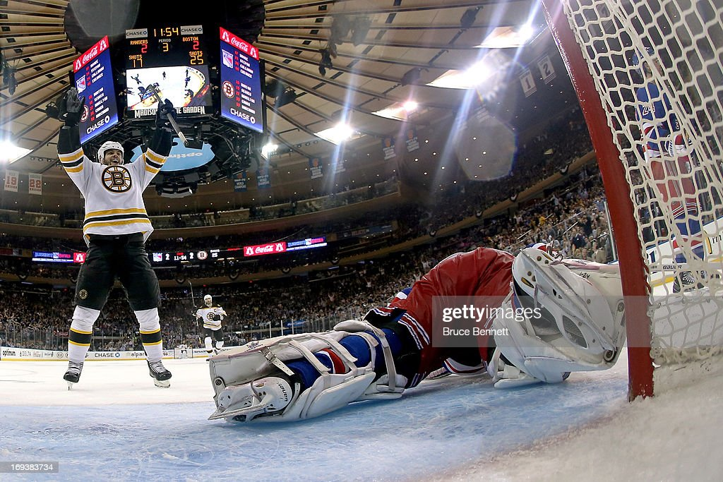 <a gi-track='captionPersonalityLinkClicked' href=/galleries/search?phrase=Nathan+Horton&family=editorial&specificpeople=204741 ng-click='$event.stopPropagation()'>Nathan Horton</a> #18 of the Boston Bruins celebrates a third period goal scored by Tyler Seguin (not pictured) #19 against goalie <a gi-track='captionPersonalityLinkClicked' href=/galleries/search?phrase=Henrik+Lundqvist&family=editorial&specificpeople=217958 ng-click='$event.stopPropagation()'>Henrik Lundqvist</a> #30 of the New York Rangers in Game Four of the Eastern Conference Semifinals during the 2013 NHL Stanley Cup Playoffs at Madison Square Garden on May 23, 2013 in New York City.