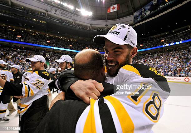 Nathan Horton of the Boston Bruins celebrates with coach Claude Julien after winning the Stanley Cup by defeating the Vancouver Canucks 40 in Game...