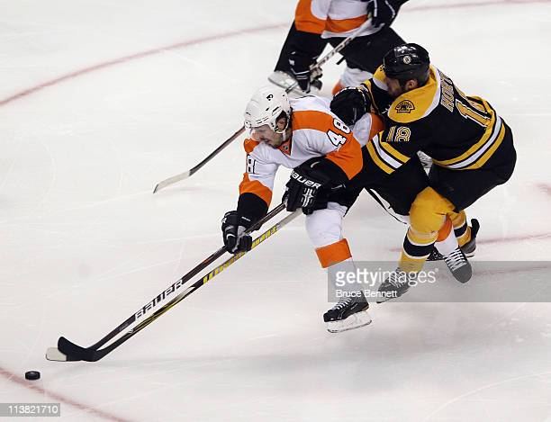 Nathan Horton of the Boston Bruins checks Danny Briere of the Philadelphia Flyers in Game Four of the Eastern Conference Semifinals during the 2011...