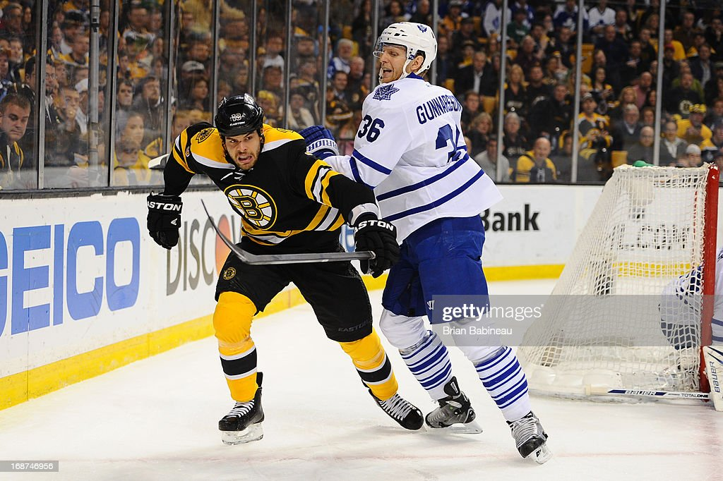 Nathan Horton #18 of the Boston Bruins fights for the puck against Carl Gunnarsson #36 of the Toronto Maple Leafs in Game Seven of the Eastern Conference Quarterfinals during the 2013 NHL Stanley Cup Playoffs at TD Garden on May 13, 2013 in Boston, Massachusetts.