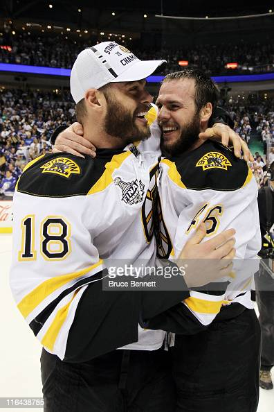 Nathan Horton of the Boston Bruins hugs David Krejci after defeating the Vancouver Canucks in Game Seven of the 2011 NHL Stanley Cup Final at Rogers...