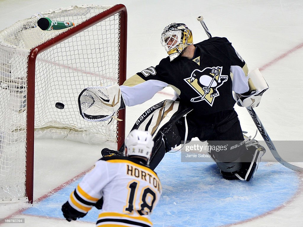 <a gi-track='captionPersonalityLinkClicked' href=/galleries/search?phrase=Nathan+Horton&family=editorial&specificpeople=204741 ng-click='$event.stopPropagation()'>Nathan Horton</a> #18 of the Boston Bruins scores a goal on <a gi-track='captionPersonalityLinkClicked' href=/galleries/search?phrase=Tomas+Vokoun&family=editorial&specificpeople=202179 ng-click='$event.stopPropagation()'>Tomas Vokoun</a> #92 of the Pittsburgh Penguins in the third period during Game One of the Eastern Conference Final of the 2013 NHL Stanley Cup Playoffs at the Consol Energy Center on June 1, 2013 in Pittsburgh, Pennsylvania.