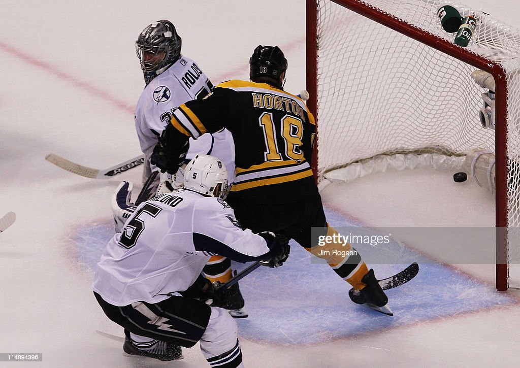 <a gi-track='captionPersonalityLinkClicked' href=/galleries/search?phrase=Nathan+Horton&family=editorial&specificpeople=204741 ng-click='$event.stopPropagation()'>Nathan Horton</a> #18 of the Boston Bruins scores a third period goal past <a gi-track='captionPersonalityLinkClicked' href=/galleries/search?phrase=Dwayne+Roloson&family=editorial&specificpeople=202970 ng-click='$event.stopPropagation()'>Dwayne Roloson</a> #35 of the Tampa Bay Lightning in Game Seven of the Eastern Conference Finals during the 2011 NHL Stanley Cup Playoffs at TD Garden on May 27, 2011 in Boston, Massachusetts.