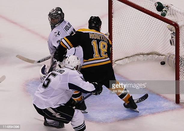 Nathan Horton of the Boston Bruins scores a third period goal past Dwayne Roloson of the Tampa Bay Lightning in Game Seven of the Eastern Conference...