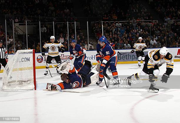 Nathan Horton of the Boston Bruins scores at 1629 of the first period against Al Montoya of the New York Islanders at the Nassau Coliseum on March 11...