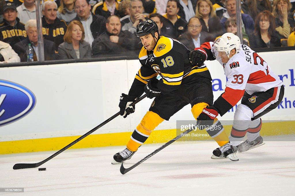 <a gi-track='captionPersonalityLinkClicked' href=/galleries/search?phrase=Nathan+Horton&family=editorial&specificpeople=204741 ng-click='$event.stopPropagation()'>Nathan Horton</a> #18 of the Boston Bruins skates with the puck against Jakob Silfverberg #33 of the Ottawa Senators at the TD Garden on February 28, 2013 in Boston, Massachusetts.