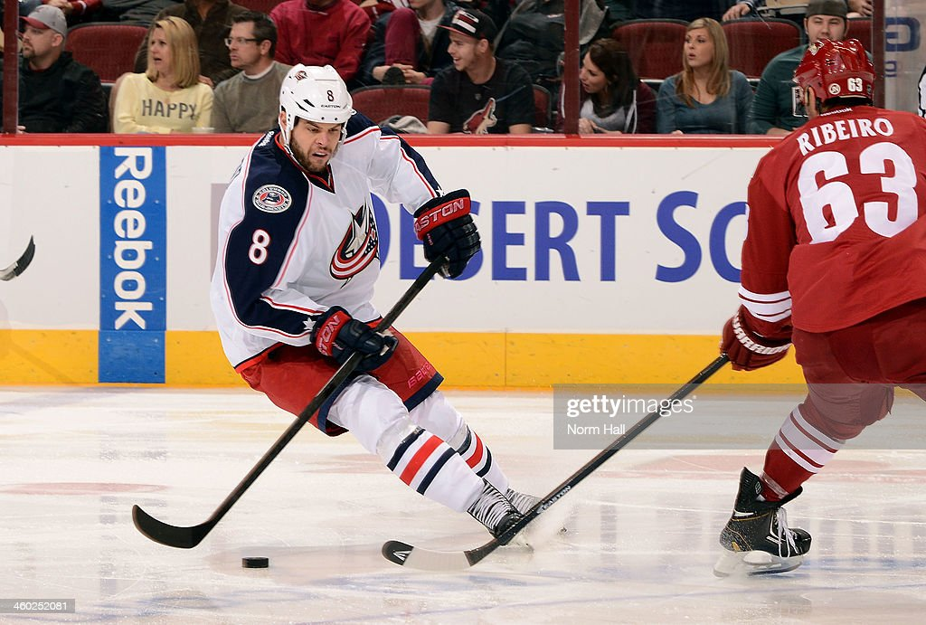 <a gi-track='captionPersonalityLinkClicked' href=/galleries/search?phrase=Nathan+Horton&family=editorial&specificpeople=204741 ng-click='$event.stopPropagation()'>Nathan Horton</a> #8 of the Columbus Blue Jackets advances the puck up ice as Mike Ribeiro #63 of the Phoenix coyotes defends during the third period at Jobing.com Arena on January 2, 2014 in Glendale, Arizona.