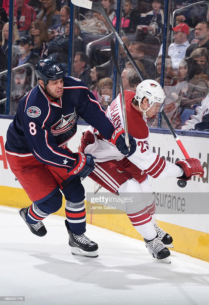 Nathan Horton #8 of the Columbus Blue Jackets and Oliver Ekman-Larsson #23 of the Phoenix Coyotes battle for a loose puck during the first period on April 8, 2014 at Nationwide Arena in Columbus, Ohio.