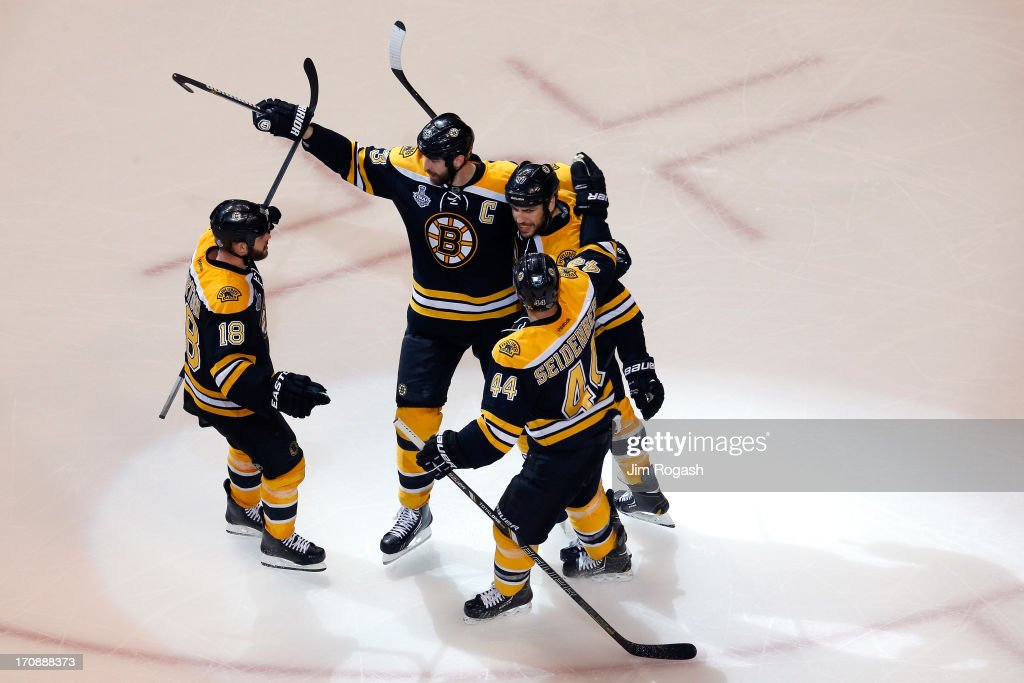 Nathan Horton Zdeno Chara Dennis Seidenberg and Milan Lucic of the Boston Bruins celebrate after a goal in the second period against the Chicago...