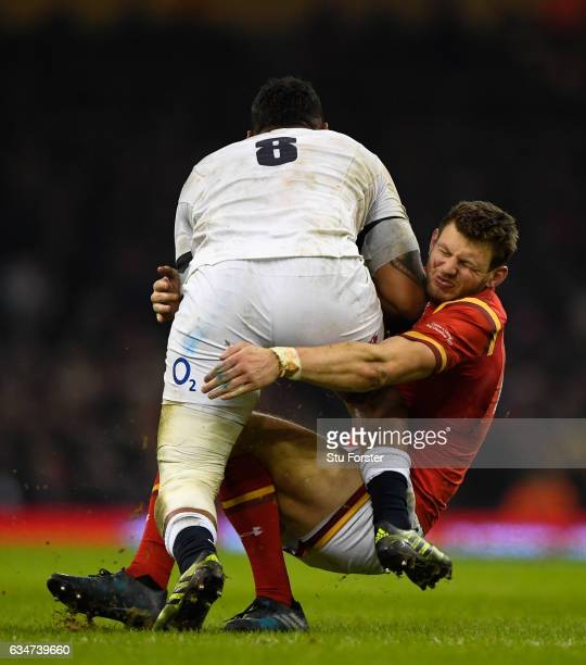 Nathan Hughes barges through the tackle of Dan Biggar of Wales during the RBS Six Nations match between Wales and England at Principality Stadium on...