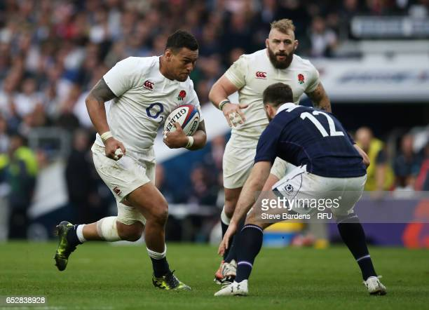 Nathan Hughes of England charges towards Alex Dunbar of Scotland during the RBS Six Nations match between England and Scotland at Twickenham Stadium...
