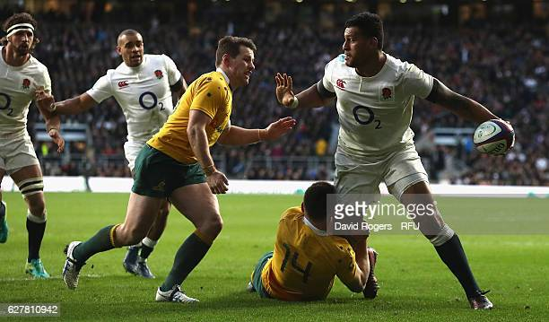 Nathan Hughes of England is tackled by Dane HaylettPetty during the Old Mutual Wealth Series match between England and Australia at Twickenham...