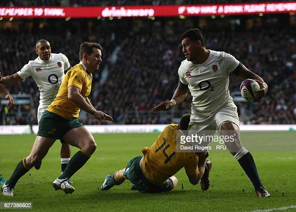 Nathan Hughes of England is tackled by Dane HaylettPetty of Australia during the Old Mutual Wealth Series match between England and Australia at...