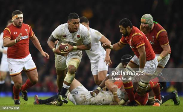 Nathan Hughes of England is tackled by Taulupe Faletau of Wales during the RBS Six Nations match between Wales and England at the Principality...