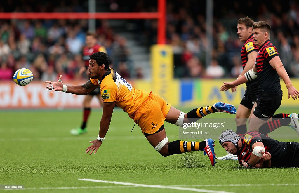 Nathan Hughes of London Wasps is takled during the Aviva Premiership match between Saracens and London Wasps at Allianz Park on October 5, 2013 in Barnet, England.