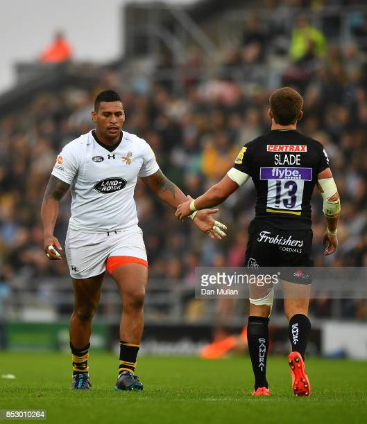 Nathan Hughes of Wasps and Henry Slade of Exeter Chiefs slap hands after a tackle during the Aviva Premiership match between Exeter Chiefs and Wasps...
