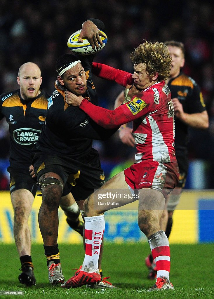 Nathan Hughes of Wasps fends off Billy Twelvetrees of Gloucester during the Aviva Premiership match between Gloucester Rugby and Wasps at Kingsholm Stadium on December 28, 2014 in Gloucester, England.