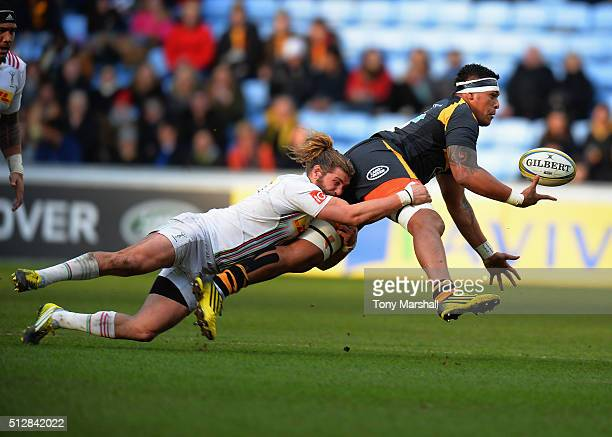 Nathan Hughes of Wasps is tackled by Luke Wallace of Harlequins during the Aviva Premiership match between Wasps and Harlequins at The Ricoh Arena on...