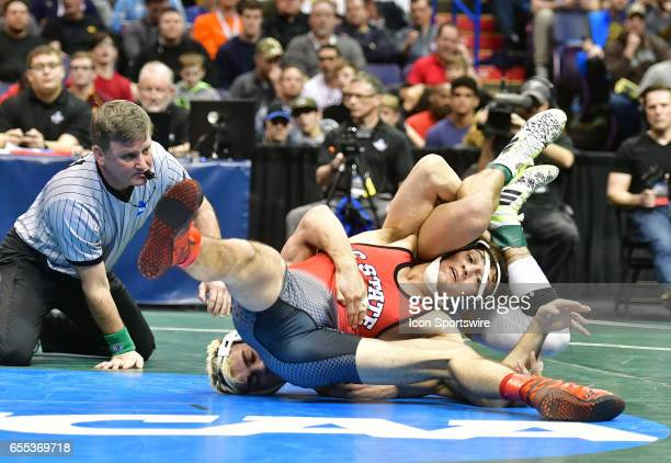 Nathan Jack of north Carolina State pins Bryce Meredith of Wyoming to finish third in the 141pound weight class in the NCAA Wrestling Championships...