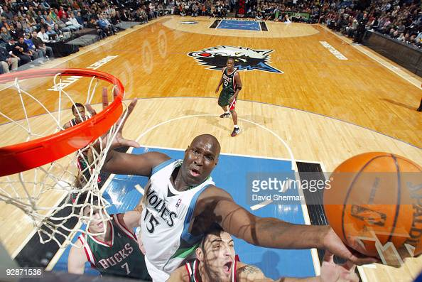 Nathan Jawai of the Minnesota Timberwolves shoots a layup against Carlos Delfino of the Milwaukee Bucks during the game on November 6 2009 at the...