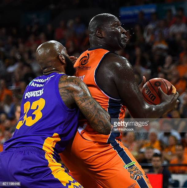 Nathan Jawai of the Taipans looks to get past Josh Powell of the Kings during the round five NBL match between the Cairns Taipans and the Sydney...