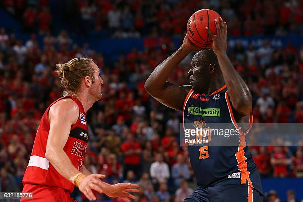 Nathan Jawai of the Taipans looks to pass the ball against Jesse Wagstaff of the Wildcats during the round 16 NBL match between the Perth Wildcats...