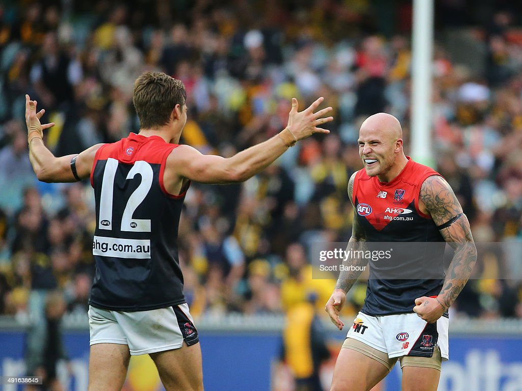 Nathan Jones and Dom Tyson of the Demons celebrate on the final siren during the round nine AFL match between the Richmond Tigers and the Melbourne...