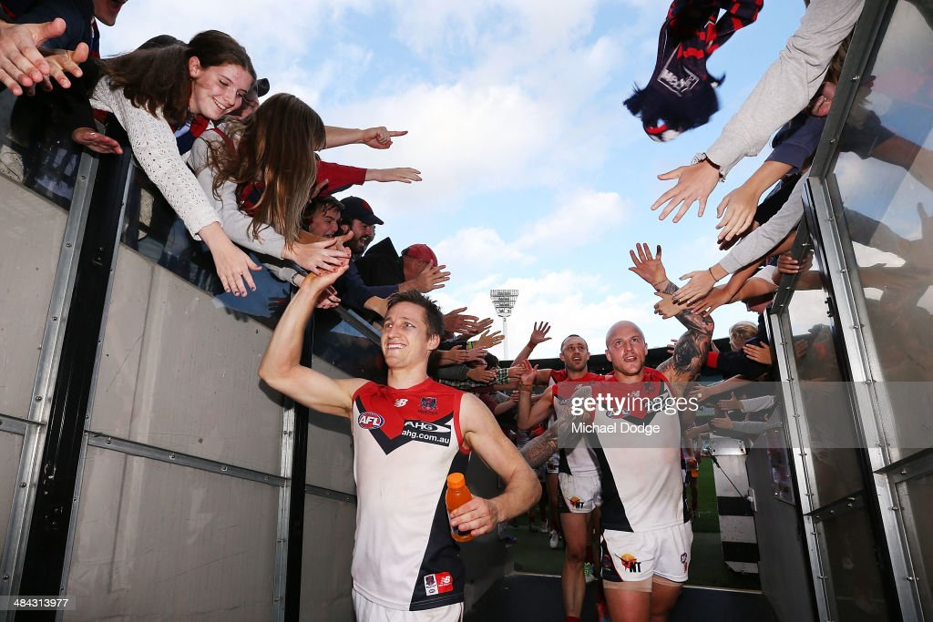 Nathan Jones (R) and Jack Grimes of the Demons celebrate their win during the round four AFL match between the Carlton Blues and the Melbourne Demons at Melbourne Cricket Ground on April 12, 2014 in Melbourne, Australia.
