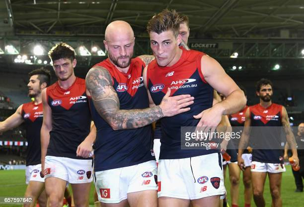 Nathan Jones and Jack Viney of the Demons celebrate winning the round one AFL match between the St Kilda Saints and the Melbourne Demons at Etihad...