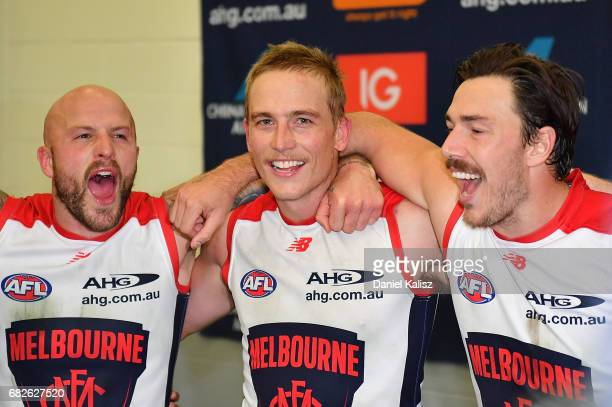 Nathan Jones Bernie Vince and Michael Hibberd of the Demons sing the club song after the round eight AFL match between the Adelaide Crows and the...