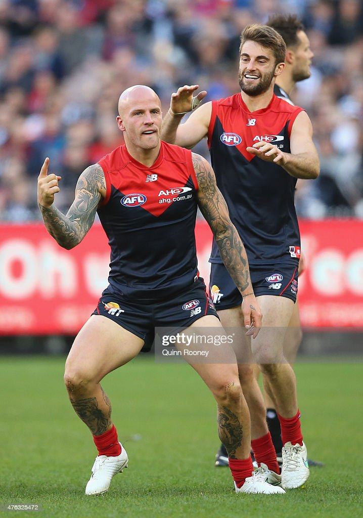 Nathan Jones of the Demons celebrates after kicking a goal during the round 10 AFL match between the Melbourne Demons and the Collingwood Magpies at...