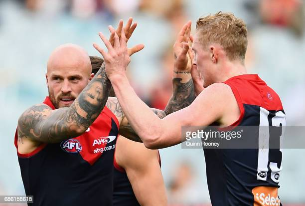 Nathan Jones of the Demons is congratulated by Clayton Oliver after kicking a goal during the round nine AFL match between the Melbourne Demons and...