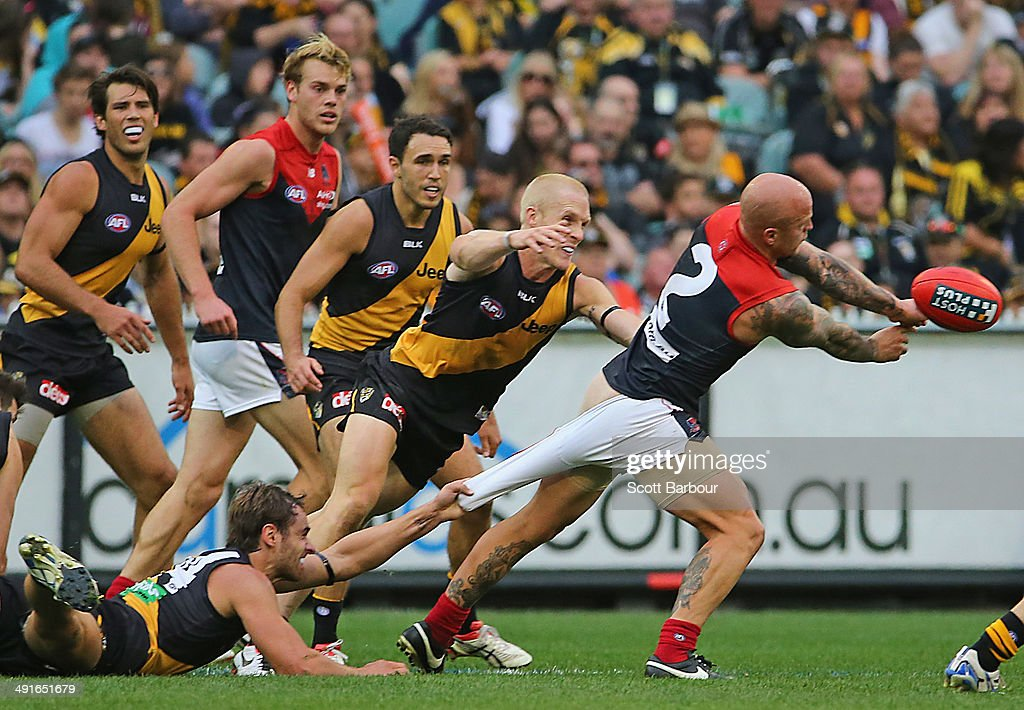 Nathan Jones of the Demons is tackled during the round nine AFL match between the Richmond Tigers and the Melbourne Demons at Melbourne Cricket...
