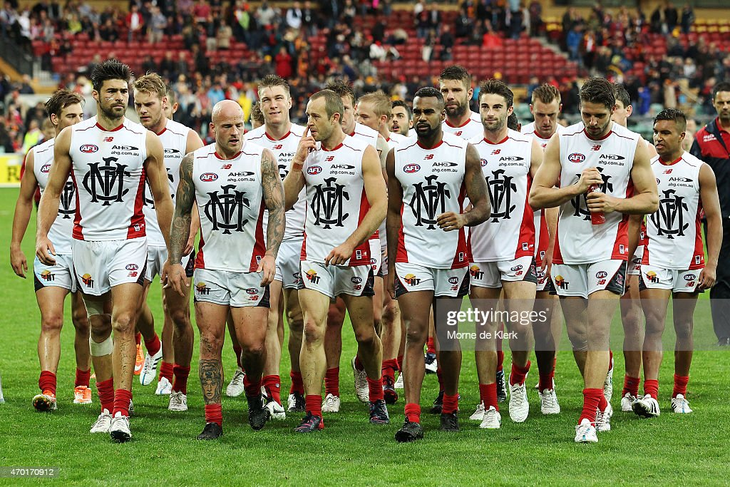 Nathan Jones of the Demons leads his team from the field after the round three AFL match between the Adelaide Crows and the North Melbourne Kangaroos...