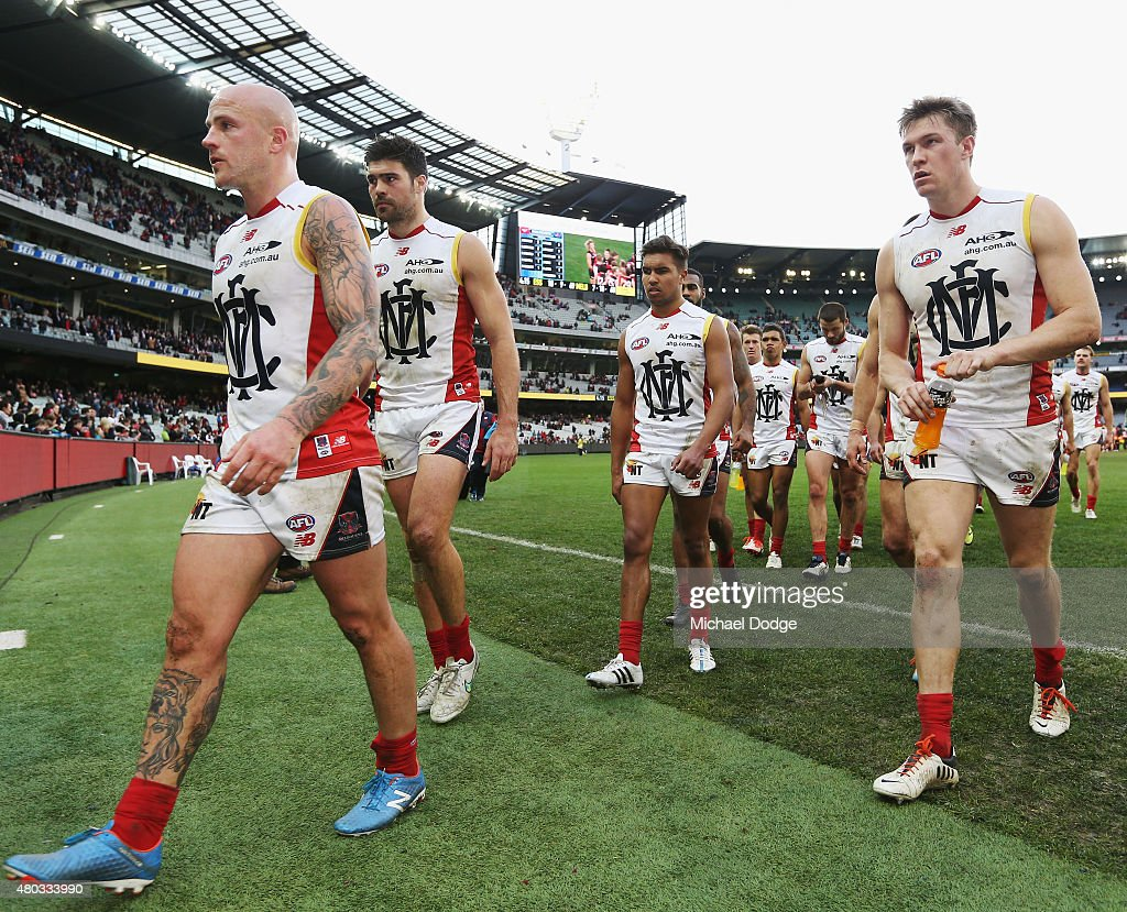Nathan Jones of the Demons leads the team off after their defeat during the round 15 AFL match between the Essendon Bombers and the Melbourne Demons...