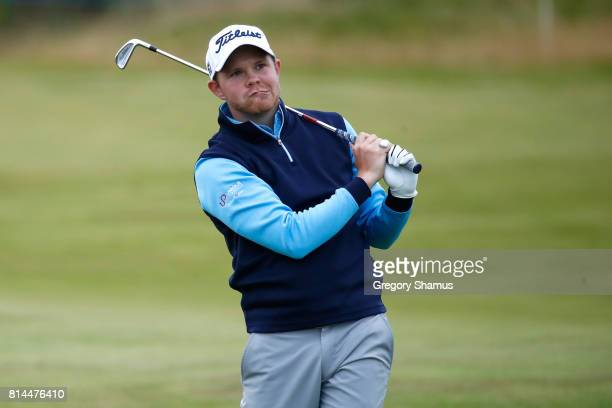 Nathan Kimsey of England hits an approach shot on the 18th hole during day two of the AAM Scottish Open at Dundonald Links Golf Course on July 14...