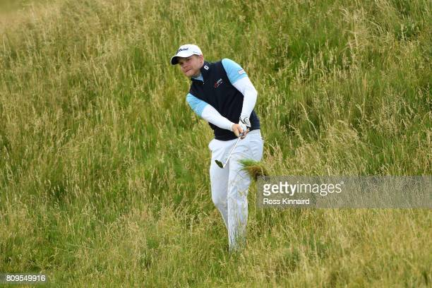 Nathan Kimsey of England hits his second shot on the 4th hole during day one of the Dubai Duty Free Irish Open at Portstewart Golf Club on July 6...