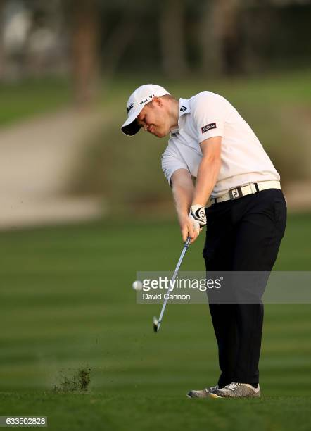 Nathan Kimsey of England plays his second shot to the par 5 10th hole during the first round of the 2017 Omega Dubai Desert Classic on the Majlis...