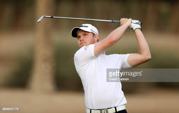 Nathan Kimsey of England plays his third shot to the par 5 10th hole during the first round of the 2017 Omega Dubai Desert Classic on the Majlis...