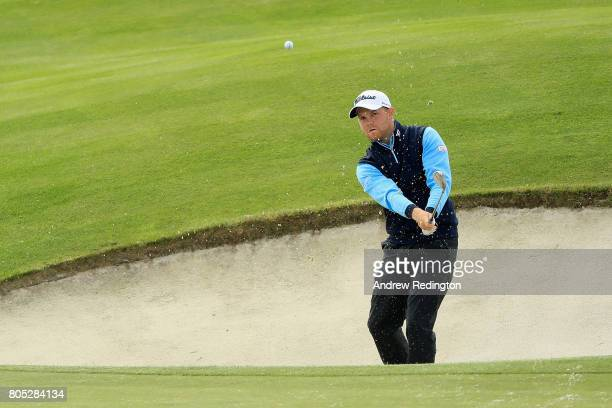 Nathan Kimsey of England plays out of the bunker during day three of the HNA Open de France at Le Golf National on July 1 2017 in Paris France