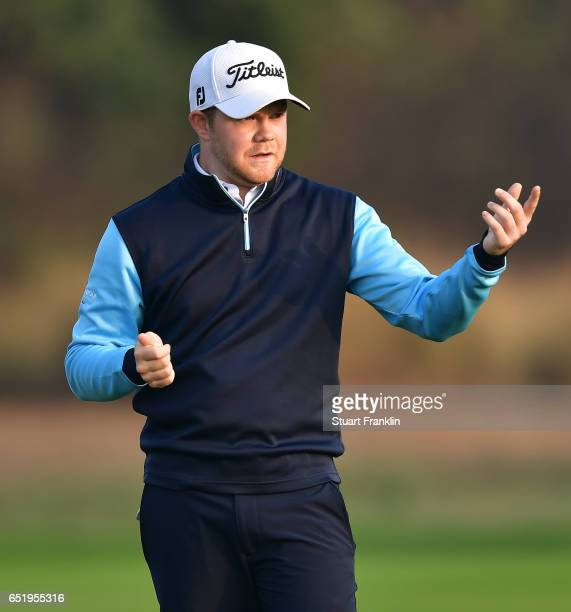 Nathan Kimsey of England ponders a shot during the continuation of the delayed second round of the Hero Indian Open at Dlf Golf and Country Club on...